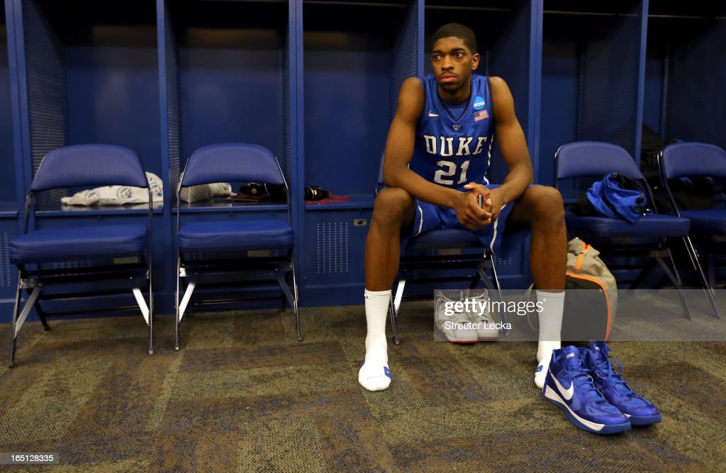 Amile Jefferson #21 of the Duke Blue Devils sits in the locker room dejected after they lost to the Louisville Cardinals 85-63 during the Midwest Regional Final round of the 2013 NCAA Men's Basketball Tournament at Lucas Oil Stadium on March 31, 2013 in Indianapolis, Indiana.