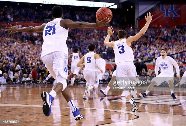 Amile Jefferson Tyus Jones and Grayson Allen of the Duke Blue Devils celebrate after defeating the Wisconsin Badgers during the NCAA Men's Final Four...