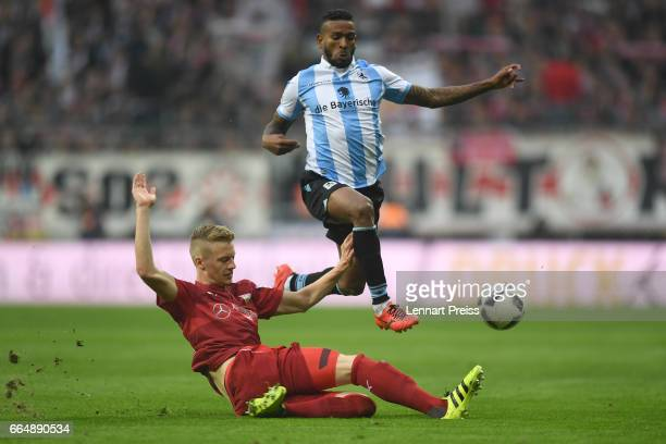 Amilton of TSV 1860 Muenchen challenges Timo Baumgartl of VfB Stuttgart during the Second Bundesliga match between TSV 1860 Muenchen and VfB...