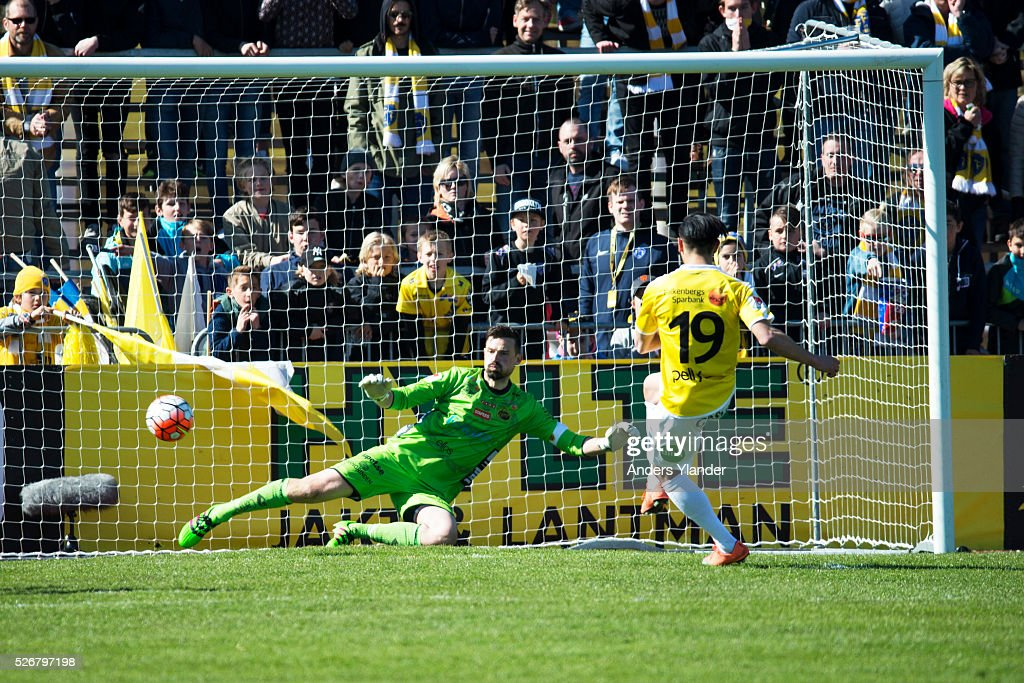 Amin Nazario of Falkenberg scores a penalty (1-1) on Kevin Stuhr Ellegaard, goalkeeper of IF Elfsborg during the Allsvenskan match between Falkenbergs FF and IF Elfsborg at Falkenbergs IP on May 1, 2016 in Falkenberg, Sweden.
