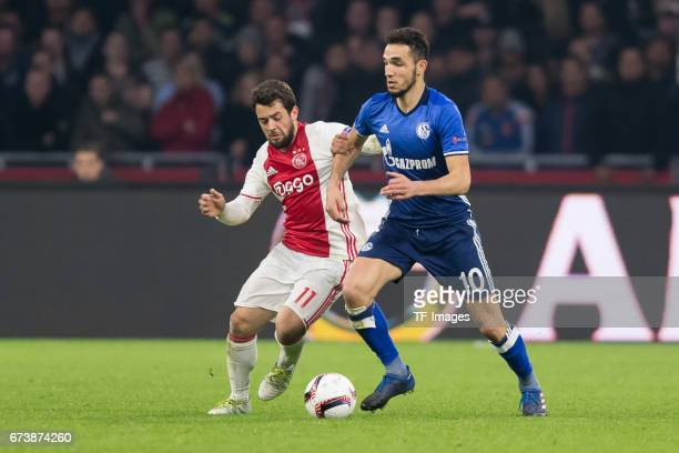 Amin Younes of Ajax Amsterdam and Nabil Bentaleb of Schalke battle for the ball during the UEFA Europa League Quarter Final first leg match between...