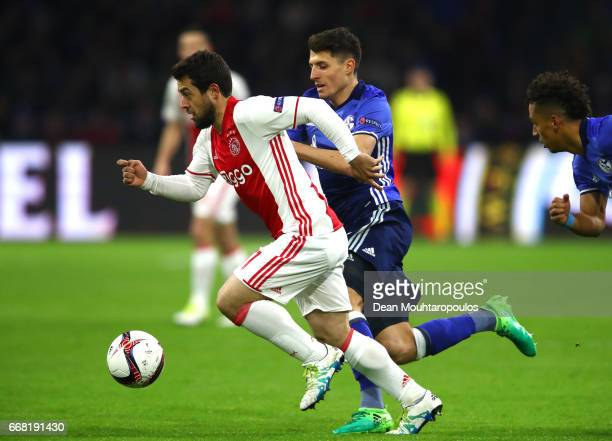 Amin Younes of Ajax and Alessandro Schopf of FC Schalke 04 in action during the UEFA Europa League quarter final first leg match between Ajax...