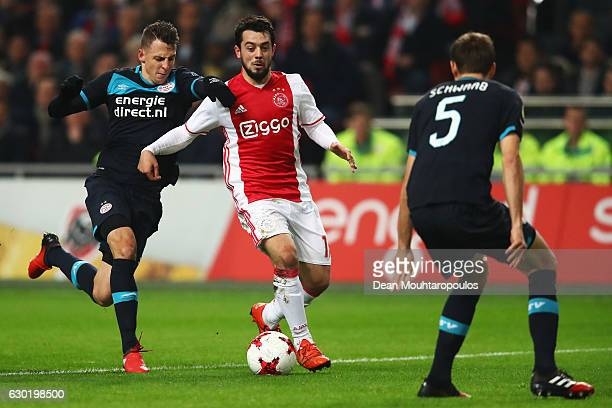 Amin Younes of Ajax battles for the ball with Santiago Arias and Daniel Schwaab of PSV during the Eredivisie match between Ajax Amsterdam and PSV...
