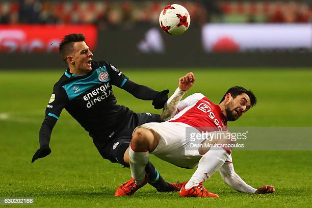 Amin Younes of Ajax battles for the ball with Santiago Arias of PSV during the Eredivisie match between Ajax Amsterdam and PSV Eindhoven held at...