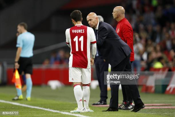 Amin Younes of Ajax coach Marcel Keizer of Ajax during the UEFA Champions League third round qualifying first leg match between Ajax Amsterdam and...
