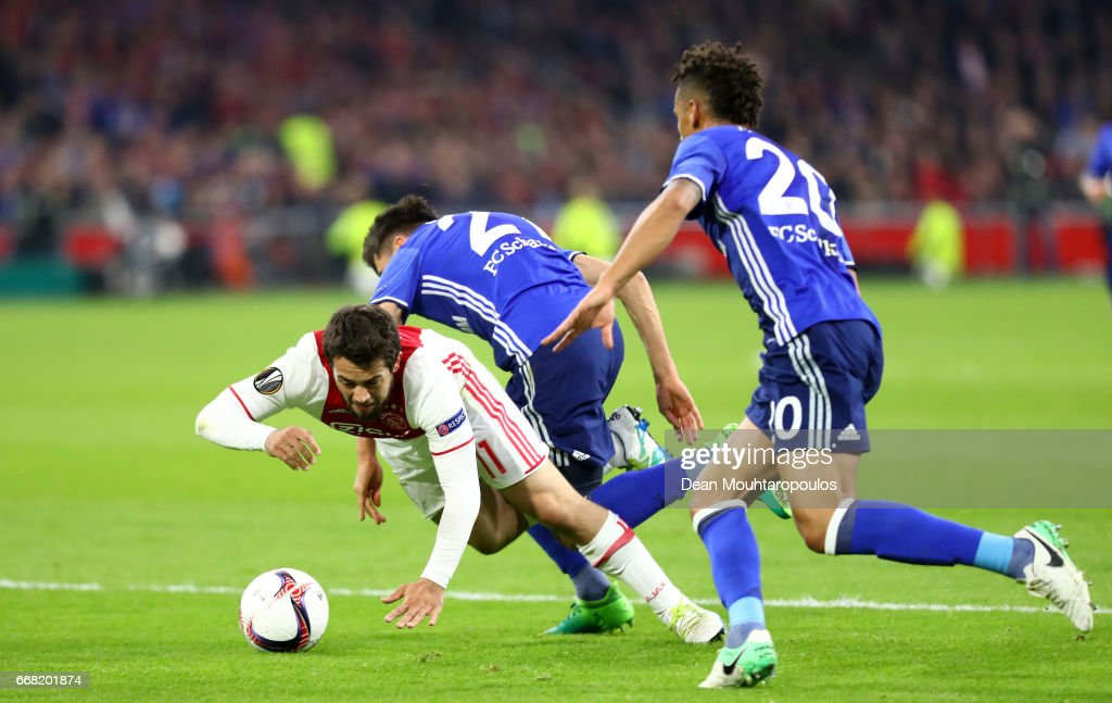 Amin Younes of Ajax is fouled by Alessandro Schopf of FC Schalke 04 leading to a penalty scored by Davy Klaassen (not pictured) during the UEFA Europa League quarter final first leg match between Ajax Amsterdam and FC Schalke 04 at Amsterdam Arena on April 13, 2017 in Amsterdam, Netherlands.