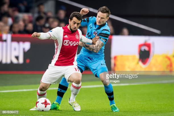 Amin Younes of Ajax Mattias Johansson of AZduring the Dutch Eredivisie match between Ajax Amsterdam and AZ Alkmaar at the Amsterdam Arena on April 05...