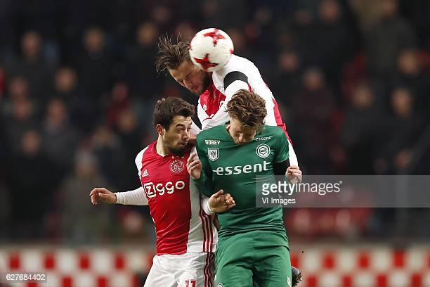 Amin Younes of Ajax Mitchell Dijks of Ajax Hans Hateboer of FC Groningenduring the Dutch Eredivisie match between Ajax Amsterdam and FC Groningen at...