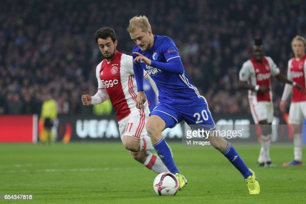 Amin Younes of Ajax Nicolai Boilesen of FC Kopenhagenduring the UEFA Europa League round of 32 match between Ajax Amsterdam and FC Copenhagen at the...