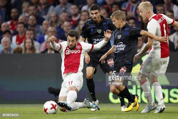 Amin Younes of Ajax Pierre LeesMelou of OCG Nice Vincent Koziello of OCG Nice Donny van de Beek of Ajax during the UEFA Champions League third round...