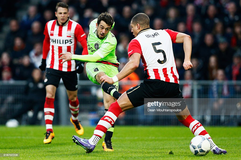 Amin Younes of Ajax runs on goal and shoots in front of Jeffrey Bruma of PSV during the Eredivisie match between PSV Eindhoven and Ajax Amsterdam held at Philips Stadium on March 20, 2016 in Eindhoven, Netherlands.