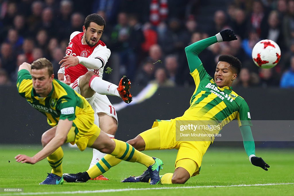 Amin Younes of Ajax shoots on goal in front of Thomas Meissner and Tyronne Ebuehi of ADO Den Haag during the Eredivisie match between Ajax Amsterdam and ADO Den Haag held at Amsterdam Arena on January 29, 2017 in Amsterdam, Netherlands.