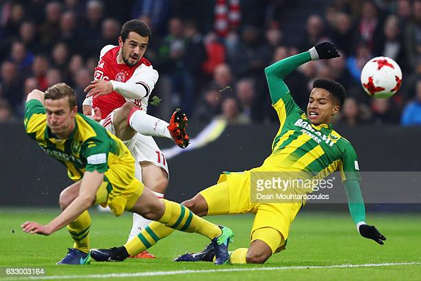 Amin Younes of Ajax shoots on goal in front of Thomas Meissner and Tyronne Ebuehi of ADO Den Haag during the Eredivisie match between Ajax Amsterdam...