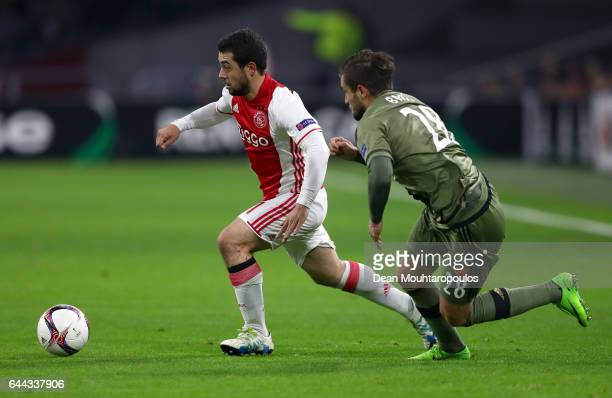 Amin Younes of Ajax takes on Lukasz Broz of Legia Warszawa during the UEFA Europa League Round of 32 second leg match between Ajax Amsterdam and...