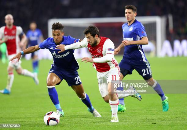 Amin Younes of Ajax takes on Thilo Kehrer of FC Schalke 04 during the UEFA Europa League quarter final first leg match between Ajax Amsterdam and FC...