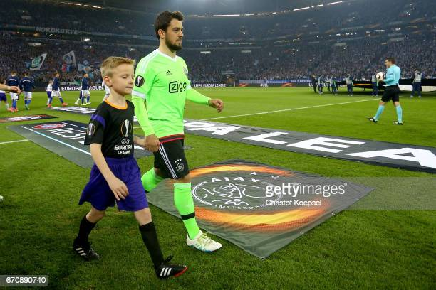 Amin Younes of Amsterdam enters the pitch prior to the UEFA Europa League quarter final second leg match between FC Schalke 04 and Ajax Amsterdam at...