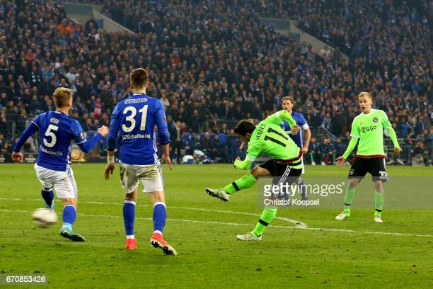 Amin Younes of Amsterdam scores the second goal during the UEFA Europa League quarter final second leg match between FC Schalke 04 and Ajax Amsterdam...