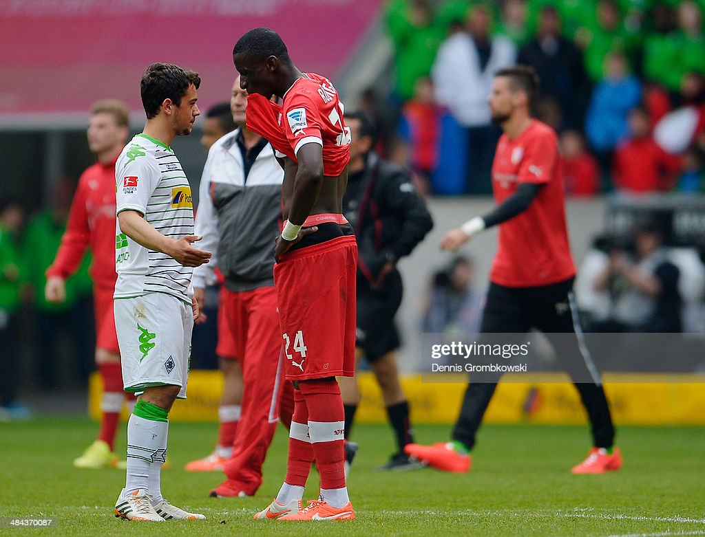 <a gi-track='captionPersonalityLinkClicked' href=/galleries/search?phrase=Amin+Younes&family=editorial&specificpeople=5862424 ng-click='$event.stopPropagation()'>Amin Younes</a> of Borussia Moenchengladbach and Antonio Ruediger of VfB Stuttgart exchange words after the Bundesliga match between Borussia Moenchengladbach and VfB Stuttgart at Borussia-Park on April 12, 2014 in Moenchengladbach, Germany.