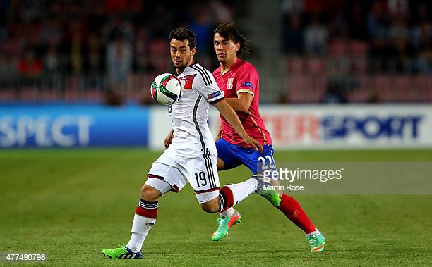Amin Younes of Germany and Filip Stojkovic of Serbia battle for the ball during the UEFA European Under21 Group A match between Germany and Serbia at...