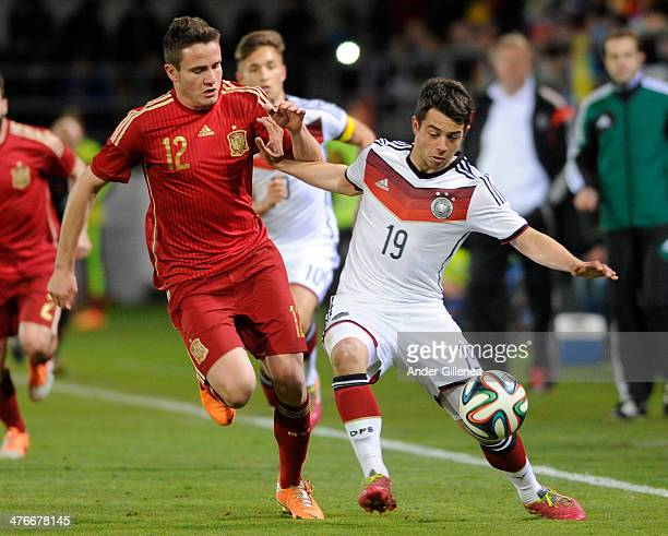 Amin Younes of Germany battles with Saul Niguez of Spain during an U21 international friendly match between Spain and Germany on March 4 2014 at the...