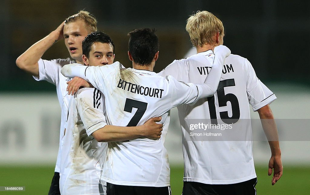 Amin Younes of Germany (2L) celebrates his team's third goal with team mates during the 2015 UEFA European U21 Championships Qualifying Group Six match between Germany U21 and Faroe Islands U21 at Auestadion on October 15, 2013 in Kassel, Germany.