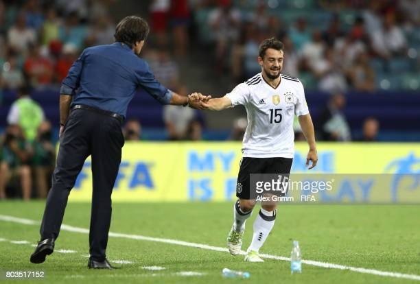 Amin Younes of Germany celebrates scoring his side's fourth goal with head coach Joachim Loew during the FIFA Confederations Cup Russia 2017...