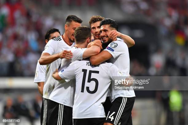 Amin Younes of Germany celebrates with teammates their teams fourth goal during the FIFA 2018 World Cup Qualifier between Germany and San Marino at...