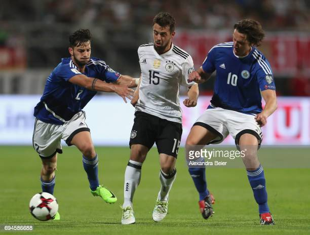Amin Younes of Germany fights for the ball with Davide Cesarini and Pier Filippo Mazza of San Marino during the FIFA 2018 World Cup Qualifier between...