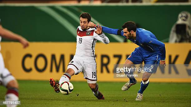 Amin Younes of Germany is challenged by Davide Zappacosta of Italy during a U21 International friendly match between U21 Germany and U21 Italy on...