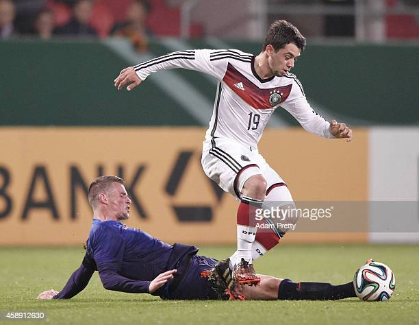 Amin Younes of Germany is tackled during the U21 Germany v U21 Netherlands International Friendly match at Audi Sportpark on November 13 2014 in...