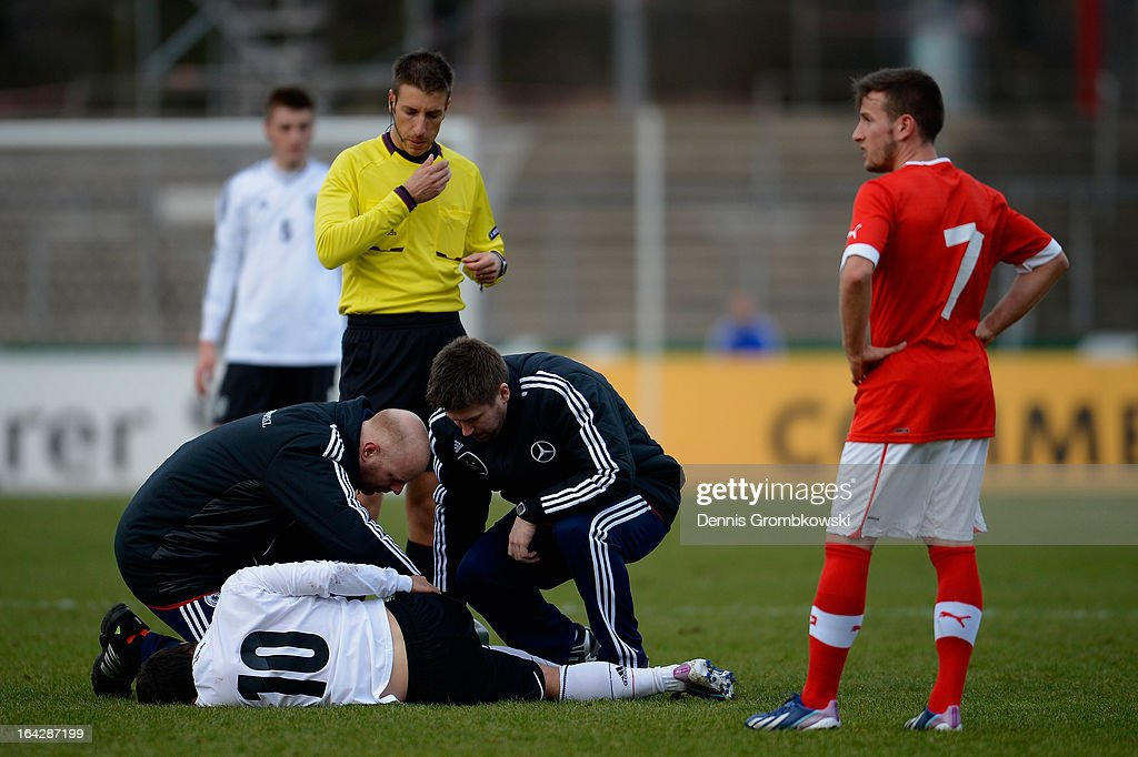 Amin Younes of Germany is treated after suffering an injury during the International Friendly match between U20 Germany and U20 Switzerland on March 22, 2013 in Cologne, Germany.