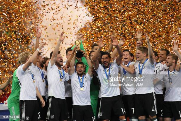 Amin Younes of Germany lifts the trophy with his teammates at the end of the FIFA Confederations Cup Russia 2017 Final match between Chile and...