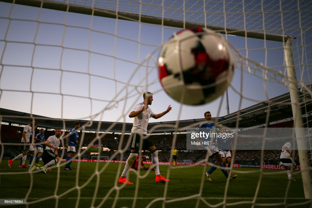 Amin Younes of Germany (R) scores a goal to make it 4:0 during the FIFA 2018 World Cup Qualifier between Germany and San Marino on June 10, 2017 in Nuremberg, Bavaria.