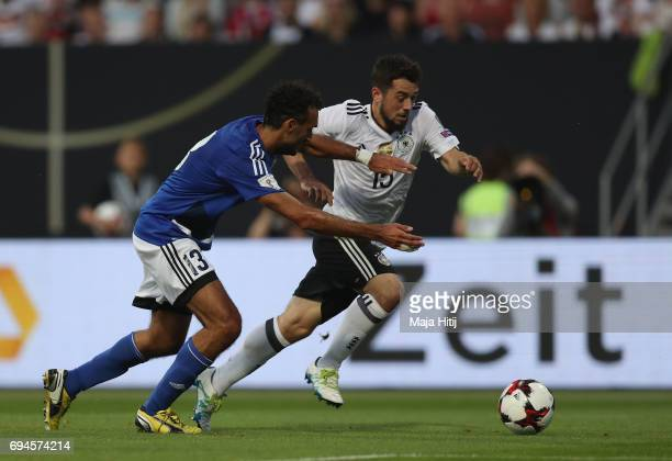Amin Younes of Germany takes the ball past Alessandro Della Valle of San Marino during the FIFA 2018 World Cup Qualifier between Germany and San...