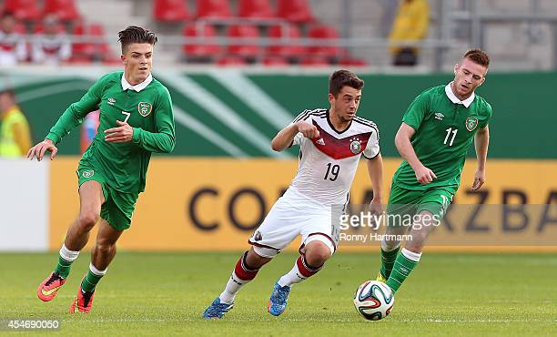 Amin Younes of Germany vies with Jack Grealish and Jack Byrne of Ireland during the Under 21 Qualifier between Germany U21 and The Republic of...