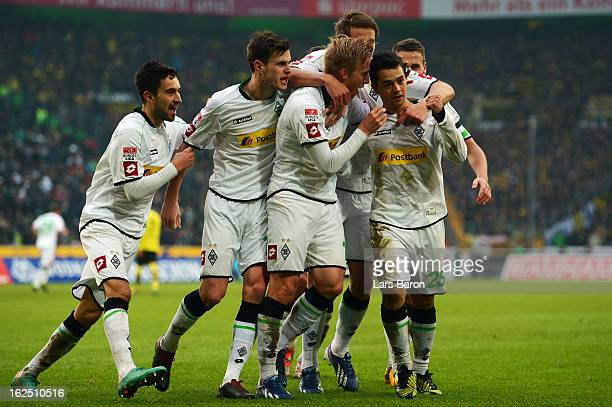 Amin Younes of Moenchengladbach celebrates after scoring his teams first goal during the Bundesliga match between VfL Borussia Moenchengladbach and...
