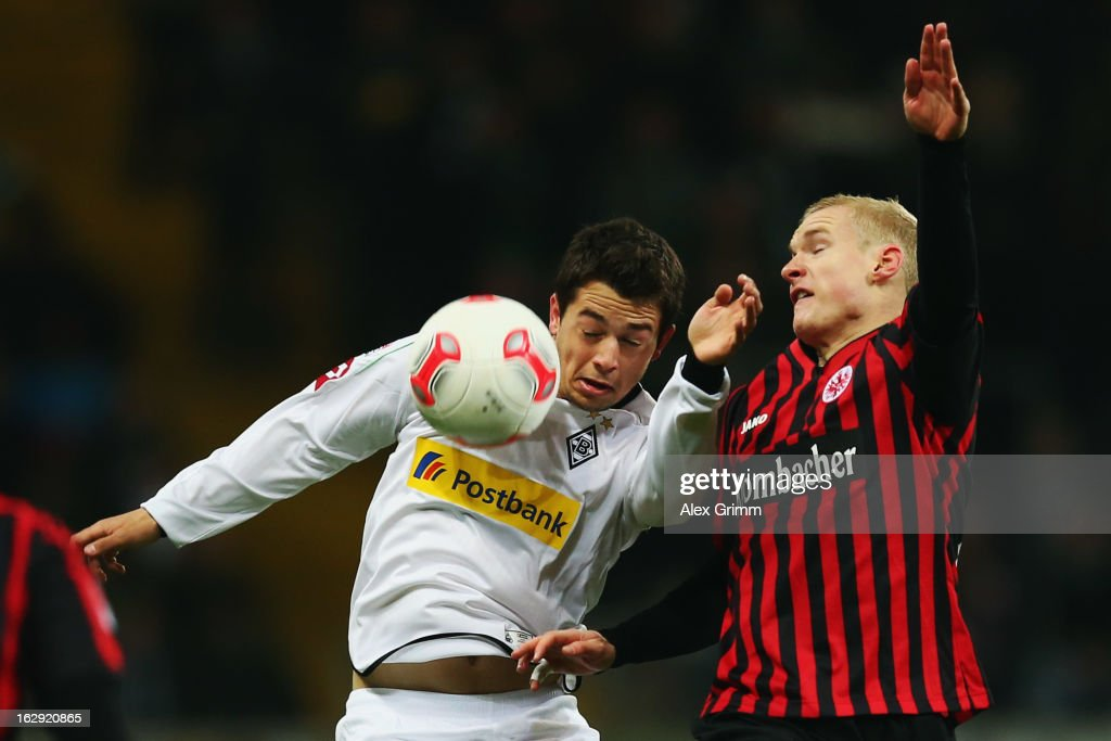 Amin Younes (L) of Moenchengladbach is challenged by Sebastian Rode of Frankfurt during the Bundesliga match between Eintracht Frankfurt and Borussia Moenchengladbach at Commerzbank-Arena on March 1, 2013 in Frankfurt am Main, Germany.