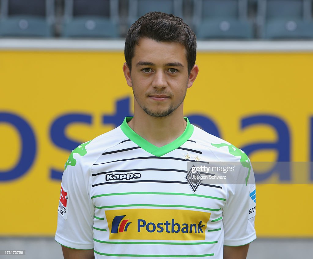 <a gi-track='captionPersonalityLinkClicked' href=/galleries/search?phrase=Amin+Younes&family=editorial&specificpeople=5862424 ng-click='$event.stopPropagation()'>Amin Younes</a> poses during the team presentation of Borussia Moenchengladbach on July 9, 2013 in Moenchengladbach, Germany.