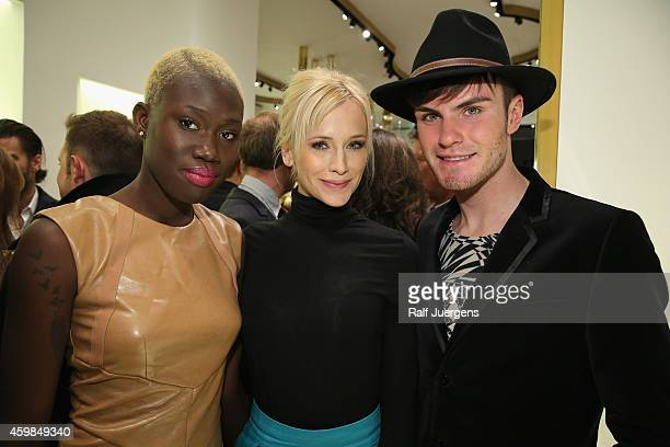 Aminata Annica Hansen and PaulHenry Duval attend the Versace Boutique Opening on December 2 2014 in Duesseldorf Germany