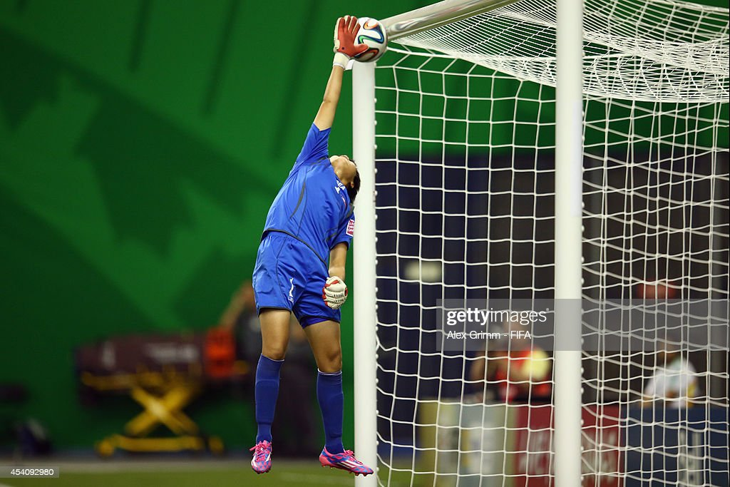 Aminata Diallo of France (not pictured) scores her team's third goal against goalkeeper Kim Chol Ok of Korea DPR during the FIFA U-20 Women's World Cup Canada 2014 3rd place match between Korea DPR and France at Olympic Stadium on August 24, 2014 in Montreal, Canada.