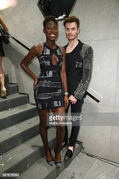 Aminata Sanogo and PaulHenry Duval attend the Philipp Plein Store Event on June 2 2016 in Duesseldorf Germany