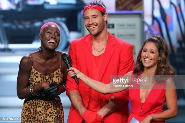 Aminata Sanogo Marc Eggers and Nazan Eckes perform on stage during the 1st show of the television competition 'Dance Dance Dance' on July 12 2017 in...