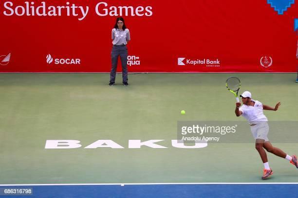 Amine Ahouda of Morocco returns the ball to Altug Celikbilek of Turkey during the Baku 2017 4th Islamic Solidarity Games Men's Semi final tennis...