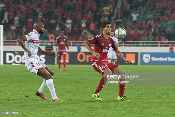 Amine Attouchi of Wydad Casablanca and Shikabala of Zamalek vie for the ball during the semifinal match of CAF Champions League between Wydad...