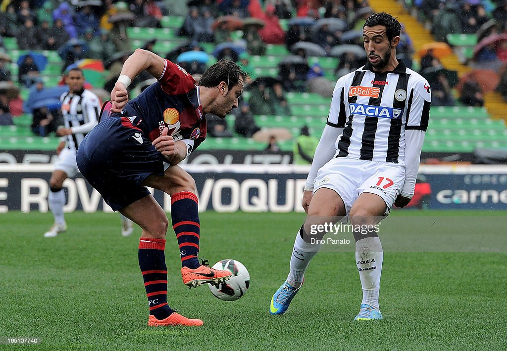 Amine Benatia (R) of Udinese Calcio competes with <a gi-track='captionPersonalityLinkClicked' href=/galleries/search?phrase=Alberto+Gilardino&family=editorial&specificpeople=215491 ng-click='$event.stopPropagation()'>Alberto Gilardino</a> of Bologna FC during the Serie A match between Udinese Calcio and Bologna FC at Stadio Friuli on March 30, 2013 in Udine, Italy.