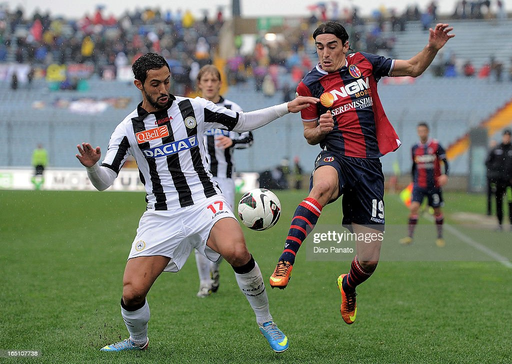 Amine Benatia (L) of Udinese Calcio competes with Lazaros Christodoulopulos of Bologna FC during the Serie A match between Udinese Calcio and Bologna FC at Stadio Friuli on March 30, 2013 in Udine, Italy.