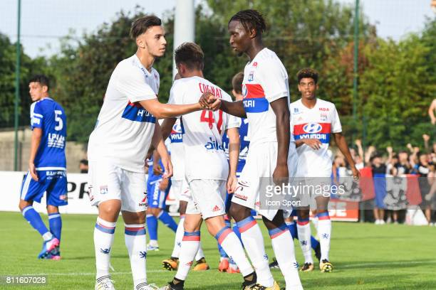 Amine Gouiri and Mapou Yanga Mbiwa of Lyon celebrate his goal during the friendly match between Olympique Lyonnais and BourgenBresse on July 8 2017...