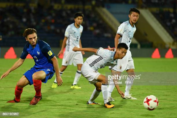 Amine Gouiri of France and Hinata Kida of Japan battle for the ball during the FIFA U17 World Cup India 2017 group E match between France and Japan...