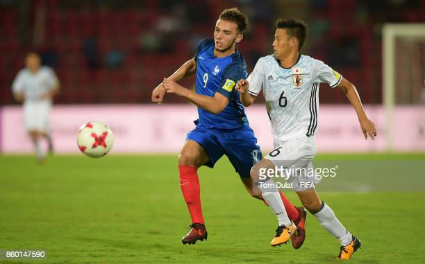 Amine Gouiri of France and Hinata Kida of Japan in action during the FIFA U17 World Cup India 2017 group E match between France and Japan at Indira...