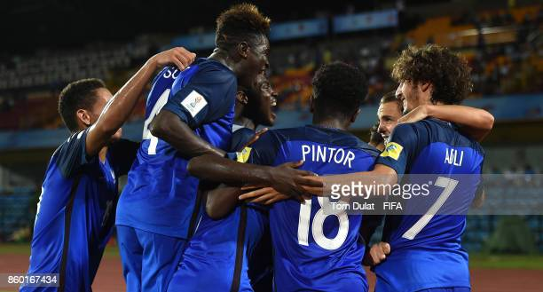 Amine Gouiri of France celebrates scoring a goal with teammates during the FIFA U17 World Cup India 2017 group E match between France and Japan at...